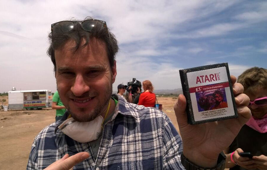Jeff Rubenstein with a rescued Atari ET game in Alamogordo