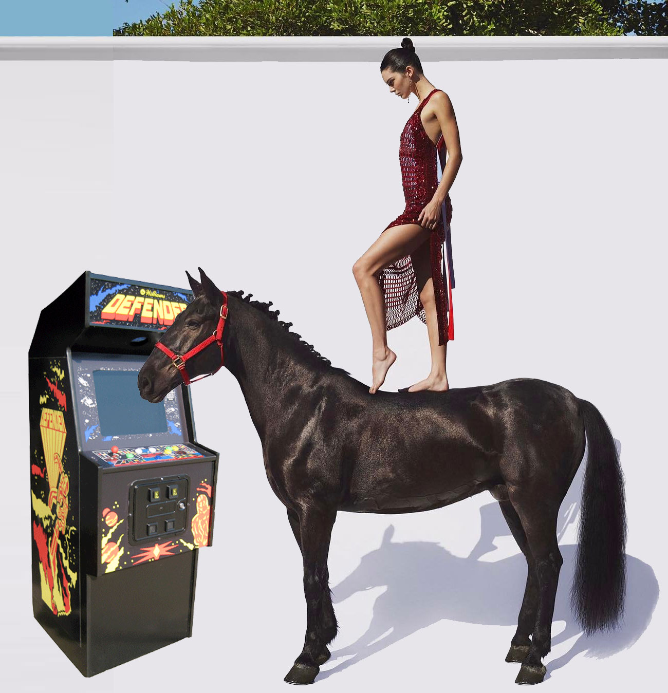 Kendall Jenner standing on a horse with Defender
